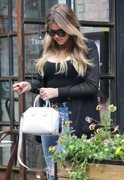 Khloe Kardashian was spotted in NYC carrying a cute mini cross-body tote.