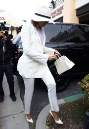 Khloe Kardashian donned a sleek white pantsuit for Easter church service.