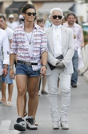 Lagerfeld was spotted in St. Tropez with his model boyfriend who sported short cuffed denim shorts with a plaid button down and high tops.