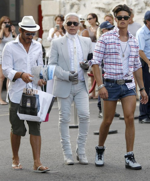 Unlike his designer boyfriend, Baptiste kept it comfy while walking the streets on St. Tropez in high-top basketball sneakers.