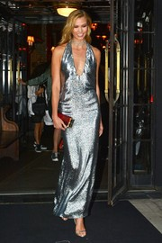 Karlie Kloss was a sparkling beauty in a metallic halter gown by Tom Ford while as she left the Bowery Hotel for an event.
