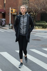 Karlie Kloss pulled her sporty look together with a pair of gray Adidas running shoes.