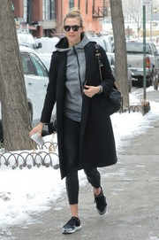 Underneath her coat, Karlie Kloss was sporty in black leggings and a gray hoodie.