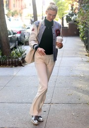 Karlie Kloss added a hint of shine with a pair of silver leather sneakers by Common Projects.