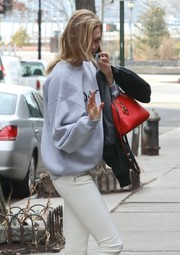 Karlie Kloss dressed up her casual attire with a chic red leather tote by Carolina Herrera for a day out in New York City.