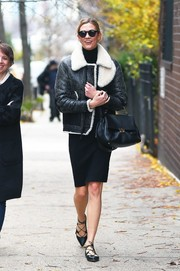 "Karlie Kloss beat the New York chill with a distressed leather and shearling flight jacket by Coach that she paired with black ""Soelae""  Sunday Somewhere sunglasses."