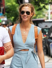 Karlie Kloss looked summer-ready in her Ray-Ban aviators and cutout dress  while out and about in New York City.
