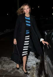 Karlie Kloss was spotted out in New York City wearing an Opening Ceremony striped dress under a black wool coat.