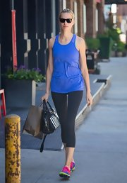 Karolina Kurkova's black workout leggings kept her look athletic chic.
