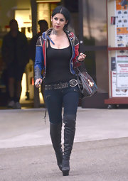 Kat Von D added some height to her weekend look with these sky-high platform knee-high boots.