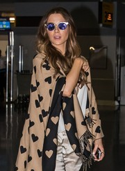 Kate Beckinsale touched down at JFK looking cool in her purple and gold cateye sunnies.