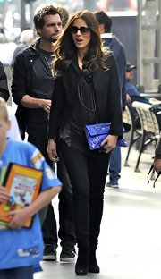 On a day out with her family Kate added a major dash of color to her outfit with a leather studded clutch. The colorful clutch was definitely the stand out piece in her ensemble.