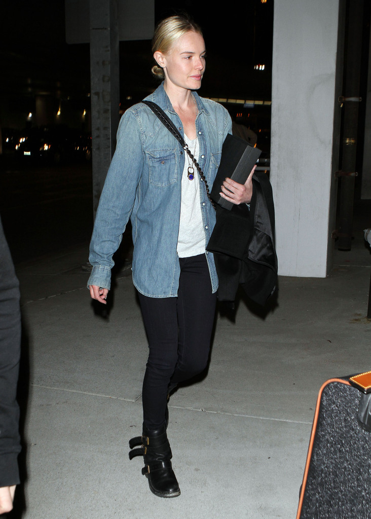 Actress Kate Bosworth arrives on a flight into Los Angeles.