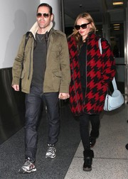 Kate Bosworth arrived at LAX looking toasty in a red and black houndstooth coat.