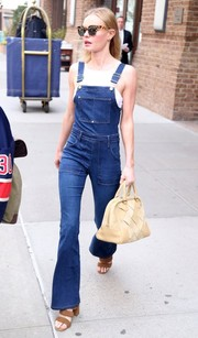 Kate Bosworth styled her boyish attire with a classic nude tote by Loewe.