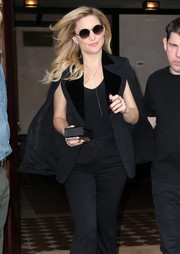 Kate Hudson was in a dark mood, pairing a purple mani with a black suit for a day out in New York City.