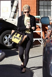 Kate Mara was spotted outside her gym wearing black leggings, a David Bowie shirt, and an oversized jacket.