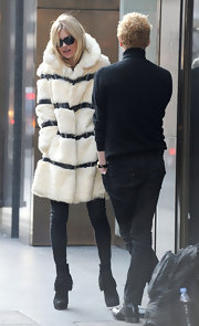 Kate Moss topped off her fur coat with black ankle boots complete with fringed detailing.