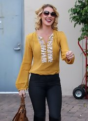 Katherine looked comfortable yet chic in this mustard beaded blouse for her birthday.