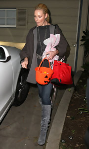 Katherine Heigl took her daughter trick or treating in a pair of gray slouchy boots. The style seems to be a favorite of Katherine's, as she's been photographed in a matching brown pair as well.