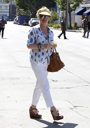 Kathy Hilton wore a comfy ensemble for shopping, consisting of white slacks, a print button-down, and wedges.