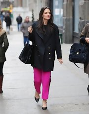 Katie Holmes always sticks to the basics like this black wool coat with gold buttons while out for a stroll in NYC.