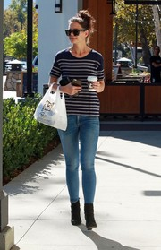 Katie Holmes paired her top with blue skinny jeans.