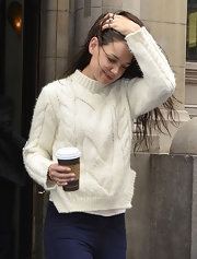 Katie Holmes strolled out in her white angora sweater and wet hair.