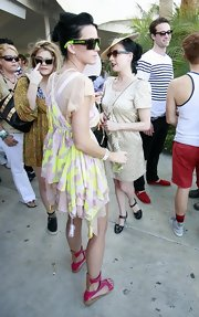 Katy looked funky and festive in hot pink patent leather gladiator sandals.