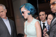 Looking to take her mind off of her failed marriage, singer Katy Perry leaves the Hyatt Hotel and heads out to Paris Fashion Week on March 1, 2012 in Paris, France. Perry has denied that her song, Part of Me, is about Russell Brand, though after hearing the lyrics,