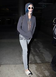 Katy Perry bundled up in a comfy hooded sweatshirt and canvas shoes.