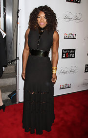 Serena Williams attended the 8th Annual Keep a Child Alive Black Ball wearing a form-fitting black dress with laser-cut designs and metal accents.