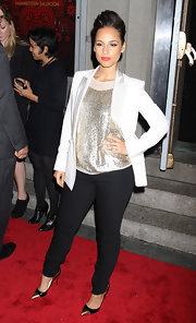 Alicia Keys struck a confident pose at the Black Ball in a crisp white blazer and a gold sequined top.
