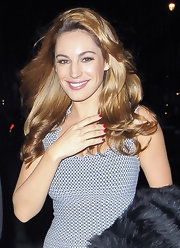 Kelly Brook went out in London wearing a glossy cherry red nail polish.