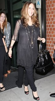 Kelly Preston teamed her all-black attire with a matching patent tote.