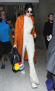 Kendall Jenner styled her knit separates with a rust-colored robe.