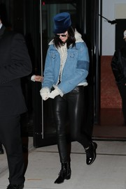 Kendall Jenner bundled up in a faux-shearling-lined denim jacket by Ambush for a night out in New York City.