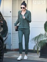 Kendall Jenner completed her comfy ensemble with white velcro-strap sneakers by Kenneth Cole.
