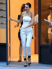 Kendall Jenner turned heads in a chic white tube top by Maticevski as she stepped out of her NYC apartment.