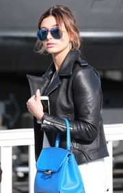 Hailey Baldwin looked tres cool wearing these blue aviators by Victoria Beckham while out in LA.