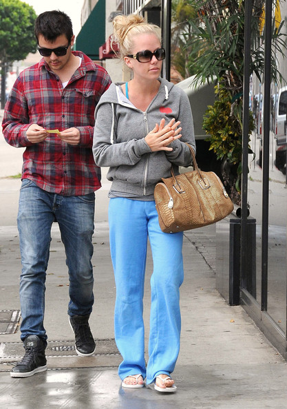 Kendra Wilkinson was spotted leaving the salon carrying a tan snakeskin tote.