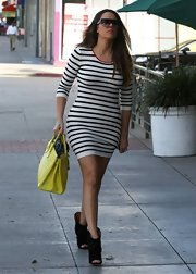 Khloe Kardashian paired this fun striped mini dress with ankle booties for a casual but classy daytime look.