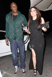 Lamar Odom wears a green suede and knit jacket while out on a date with Khloe Kardashian.