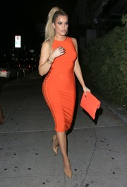 Khloe Kardashian kept her styling minimal with a pair of plain nude pumps by Christian Louboutin.