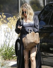 Khloe Kardashian was spotted at a studio in Westlake toting a tan fur bag.