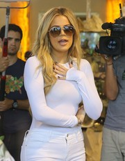 Khloe Kardashian hid her eyes behind a pair of aviator shades while shopping in West Hollywood.