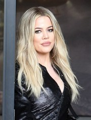 Khloe Kardashian styled her hair with a center part and a slight wave for a day out in Los Angeles.