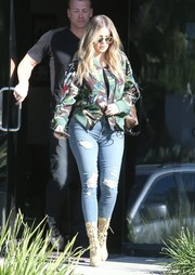 Khloe Kardashian completed her street-chic look with nude lace-up boots by Balmain.