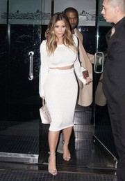Kim Kardashian completed her fierce look with a pair of Giuseppe Zanotti snakeskin-print ankle-strap sandals.