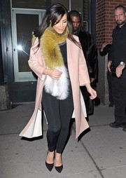 Kim Kardashian added major glamour with a Marni fur scarf.